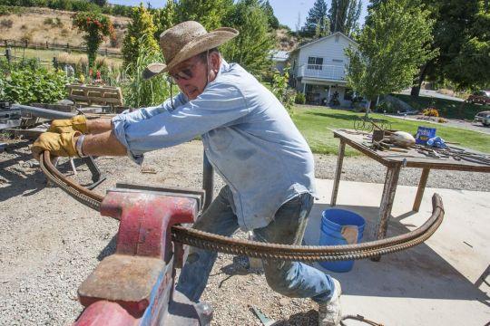 Jack Peart making Kokopelli figure. Jack Peart making KOKOPELLI figure: A Hobby You Can Take Up At Any Age.